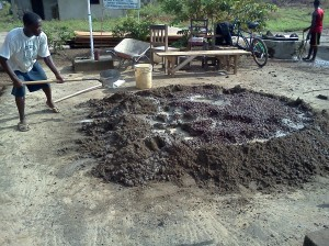 MIXING THE MORTAR : GUTTER SAND, CRUSHED ROCKS & CEMENT